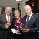 John Byrne at the launch of his book 'The Byrne Family' with Ruairí Quinn and Anne Ferris