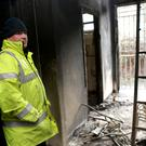 Kilmacanogue Chairman Marc Quinn surveying the damage last week following the second fire