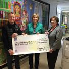Mark Keating, CEO of Whitewater, Mairead Lee on behalf of St John's Cancer Ward in Our Lady's Hospital for Sick Children in Crumlin and Liz Nangle, MD of Whitewater - all of whom hail from Bray - at the presentation of a cheque for a fantastic €10,000 to St John's Cancer Ward, following Mark's Walk For Their Lives expedition in the Balkans