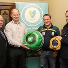 John Hopkins chairman of Kilmac Community First Responders, Ken O'Dwyer from Flashpoint and David Greville from Heart Safety present the new cabinet and defibrillator to Marc Quinn