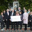 Representatives from St Gerard's presenting the cheque to John Irwin of The Jack and Jill Foundation