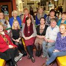 Liz McManus launches the Little Bray Creative Writing Group Exhibition at Bray Library: (L-R) Caroline Bracken, Patricia Berkery, Paula Hayes, Liz McManus Anne Harding, Olwen Dixon. Front: Maria Hyland Casey, Mary Fleming, Barbara Messitt, Marion Dutton, Tony O'Carroll, Shirley McClure