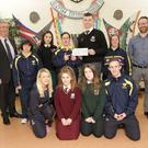 St Kilians students presents the proceeds from their Seachtain na Gaeilge 24 hours of speaking Gaeilge to Lakers: (L-R) Principal John Murphy, Mary Foley, Head Girl May Lung Chong, Daniel Ryan, Head Boy Theo Farrell, Lisa Warner, An tUasal S. Mac Cormaic. Front: Lisa O'brien, Kacie Gaule, Alana Maher, Graham Hillick
