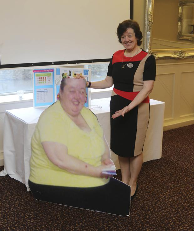 Carol Ann Curley from Roundwood with a picture of herself before she lost an amazing 13 stone and four pounds in 15 months