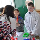 Teacher Ms Grogan with Shane Farrell,Chloe Murphy, Tadhg Devlin and Jodie Stevenson as they investigate magnetism during the St Fergal's NS 'Science Display Day'