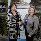 Annie Verwijis hands over the Chain of Office to incoming president Sarah Wray at the Soroptimists AGM at Chamber House