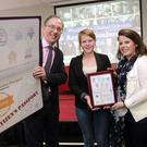Lauren Murphy and Tara Reilly from Bray-North Wicklow Youthreach receive their award from the Director of the Civil Society Unit at Irish Aid, Julian Clare, at the WorldWise Global Schools Conference in Limerick, last week