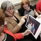 Superquinn Reunion at the Royal Hotel: Ann Hunt, Kate Mulkerrins and Mary Bennett Knight looking at photos from Superquinn through the years
