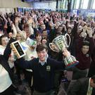 Overall winner Luke Byrne from Colaiste Chraobh Abhann proudly holds his trophies aloft for the Croke Park crowd