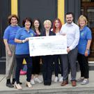 The Mollys Kilcoole present a cheque for over €3,600 to Greystones Cancer Support raised at their Shave or Dye Night. Pictured (L-R) Kathleen Kelleher, Eileen Horan, Laura Greene, Anne Doodey, Rachel Robson, Ian Robson and Eileen Morris
