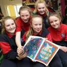 Louise McCormack, Ashleigh Cowan, Caitlin Mangan, Jami Hussey, Katie Ward and Ellie Devlin with their book 'Nibble's Big Adventure'