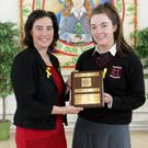 Principal Emma Raughter presenting the Lions Club Student of the Year award to Rachel Hand