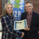Sarah Lewis receives her certificate from Prof Willie Donnelly, President of WIT