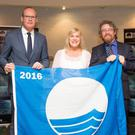 Minister Simon Coveney, Blue Flag manager Eilish Kelly and Michael John O'Mahony of An Taisce
