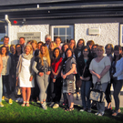Students and volunteer tutors from Fáilte Isteach Kilcoole outside Kilcoole Community Centre
