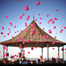 Pink balloons released into the sky in memory of Merryn