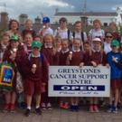St Kevin's 4th class pupils enjoy ice-cream after making their donation