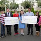 The St Fergals graduation class make a donation to the Make A Wish Foundation and the Greystones Cancer Support: (from left) Conor Fullerton, Joseph Kelly, Principal Tom Sargent, Matthew O'Neill, Christine Hamilton, Joe Carroll, Nikki Phang and Josh McGlone