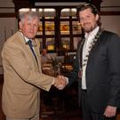 Cllr Brendan Thornhill hands the chains of office to Cllr Steven Matthews