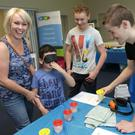 Aisling Foran and her sons Aidan and Odhran having a sensory experience with Josh Loveridge