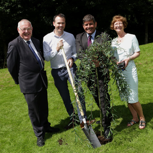 Principal and Vice Principal of Colaiste Raithin Gearóid Ó Ciaráin and Nóirín Ni Chonghaile plant a tree to mark the occasion with John Brady TD and Minister of State Andrew Doyle
