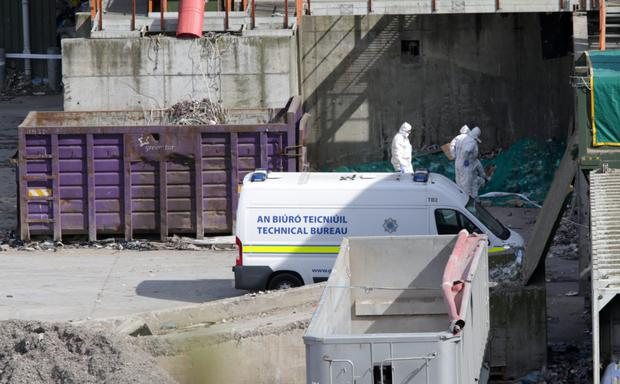 Gardai examining the scene where the remains of baby Alannah were found at the Greenstar recycling facility in Fassaroe
