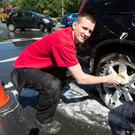 David Murray from Woodies Bray washing cars