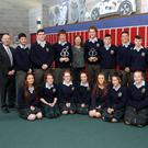 Pride of Ireland 2016 carers of the years Jimmy and Joe Murphy with their class 6KRE and vice principal Ms Buckley, Principal Mr Eivers, Siobhan Cluskey link person, Mr Farrell and Mr RIce