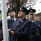 Sgt Colm Corrigan raising the flag at the end of the ceremony
