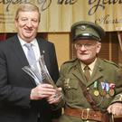 Pat Casey T.D presents the 1916 Commemoration award to David Owens from Arklow