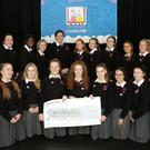 Students from the Loreto Bray LCVP talent show with the cheque for €1,475 which they raised for the Laura Lynn Foundation