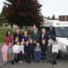 Deputy Principal Sarah Hickey, Robert MacClancy, Principal Caroline Kennedy, Jerry Teehan, Danny Bohan, Mily Gleeson and pupils from class 2 and 3 and their new bus