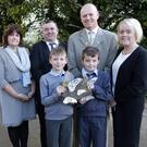 Wicklow County Council's Theresa O'Brien and Michael Nicholson along withh Cllr John Snell, cathaoirleach of Wicklow Municipal District, present a model of the butterflies worked on by Glebe School to Rory Thornbor, Lorcan O'Donohue and Principal Sandra Bryan