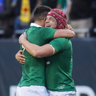 Josh van der Flier, right, and Conor Murray celebrate victory against New Zealand at Soldier Field in Chicago, USA