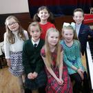 Competitors in the Ledwidge Cup solo singing under 10, (L-R) Emily Walker, Lucy Caulfield, Elliott Kelly. Front: Beth Murray, Holly Prestage, Róisín Vigors