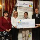 Theresa O'Brien, Michael Nicholson and Mary Tuite, Wicklow Co Council, Sinead Tarmey and Bill Porter, Wicklow Hospice Foundation, and Tom Grant, Glendalough Hotel, at the People of the Year cheque presentation for €6,894