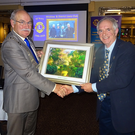 Lions President, Tony Lyons, presents Lions District Governor, Paul Allen, with a photograph
