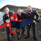 Peter Prunty, Damien Meaney and James Wright of the Order of Malta and Annette Plunkett of Five Loaves get ready for the swim