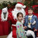 Ava and Alex Bailey with Santa in his grotto