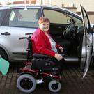 Bridget Evans with her specially-adapted car, which allowed her to drive again for the first time in 18 months last Thursday
