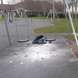 The burned out bin by the swings at Ballywaltrim playground