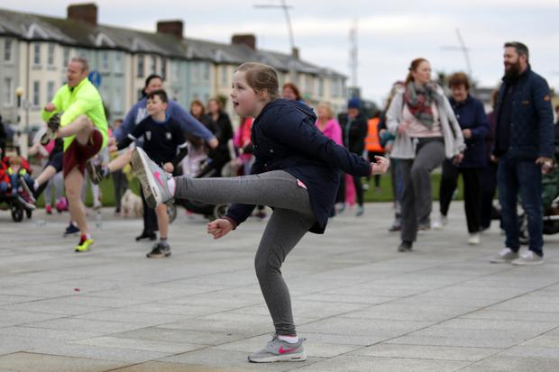 Kathlyn Doonan kicks her leg up during the warm-up with Pete Taylor in Bray