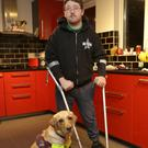 Bray man Padraic Moran at home with his assistance dog, Gail.