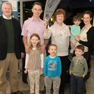 Kathleen Mulligan and her family receive the keys to a new car