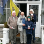 Pat and Lourde Crotty and their grandson PJ with Arthur Bogomil Burton and the two flags he carries on his journeys
