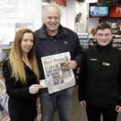 Mary Fogarty of the Bray People, cash winner William Micklem and staff member Josh Shortt at the Esso Station in Kilmacanogue