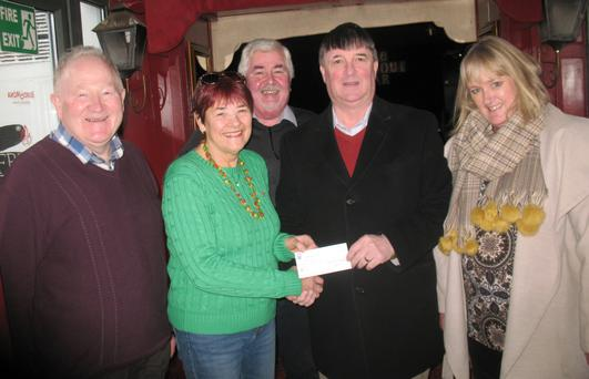 Patricia Wojner and Suzanne Cox from Open Door accept the cheque from John Smith, Mick Lernihan, Tom Conway from the Bray branch of the Garda Siochana Retired Members Association