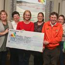 Participants in the first ever Wicklow Hospice Operation Transformation presenting the €1,500 they raised to representatives of Wicklow Hospice Foundation