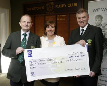 Greystones Rugby Club present the proceeds of Ladies Day to Irish Cancer Society: Chairman Gary Nolan, Mary Molloy, Irish Cancer Society, and President Jerome O'Brien