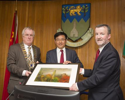 Wicklow County Chairman Pat Fitzgerald and Wicklow County Manager Bryan Doyle make a presentation Chinese Ambassador Yue Xiaoyong